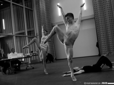 Mason Manning, foreground; Caroline Haidet, left; and Celeste Robbins, right (floor) rehearsing in the Wyly Theatre