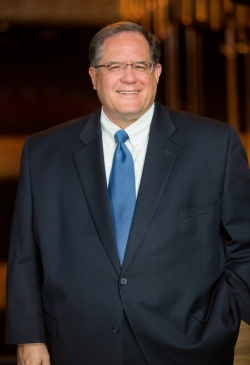Doug Curtis, President & CEO