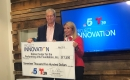 Debbie Storey, President & CEO, receiving Project Innovation Grant check